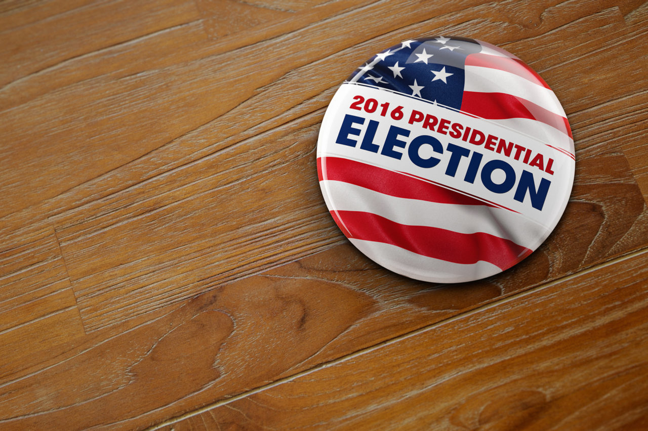 2016 US Presidential Election Button on wooden surface