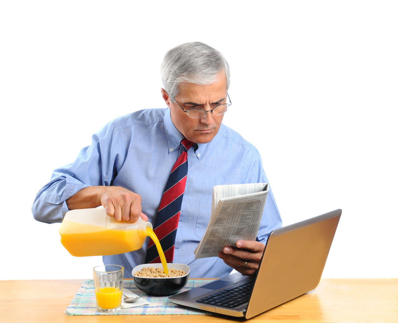 Middle Aged Man Pouring Orange Juice into His Cereal Bowl