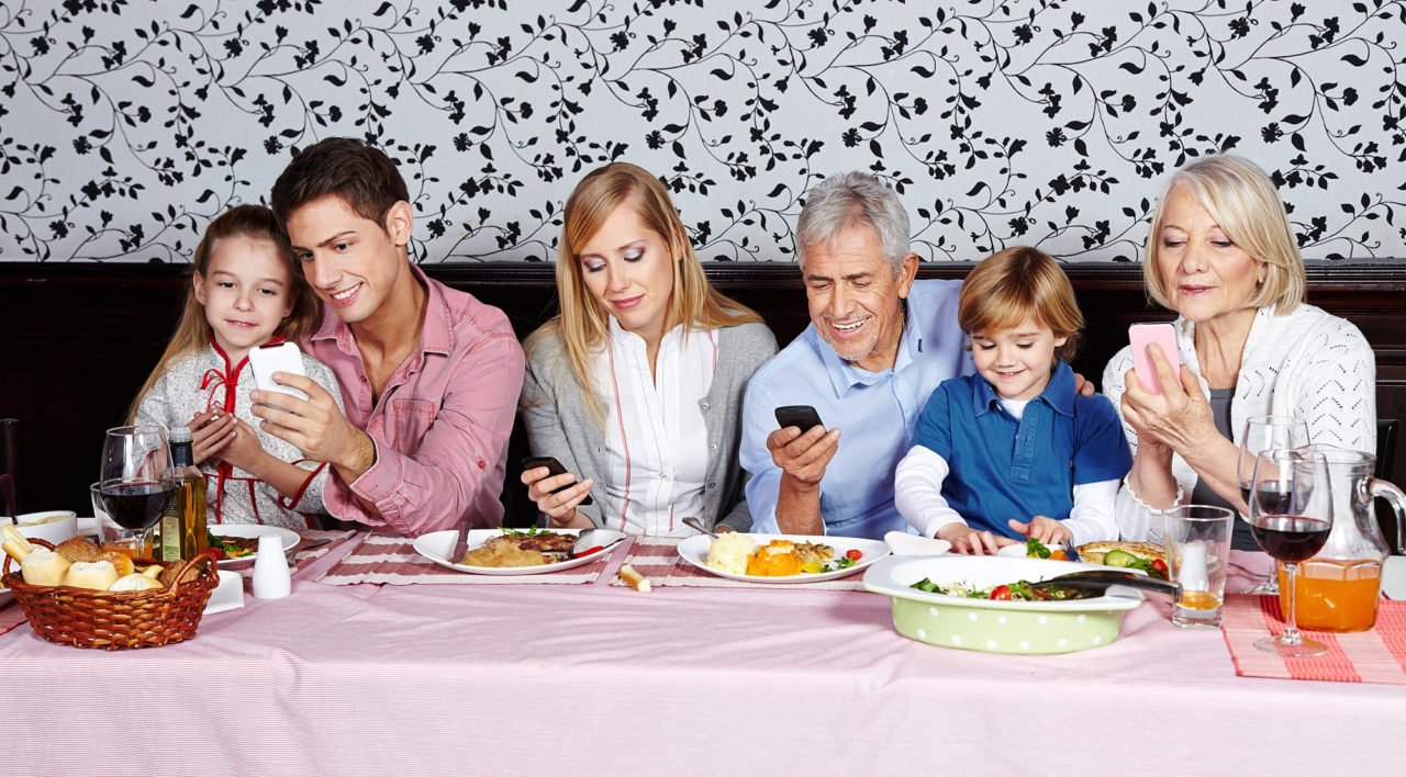 Family looks at their smartphones