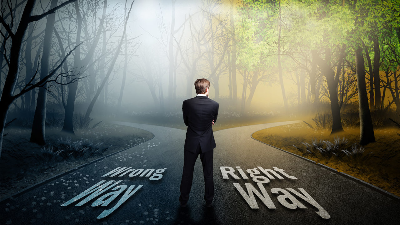 businessman has to choose what is the right way