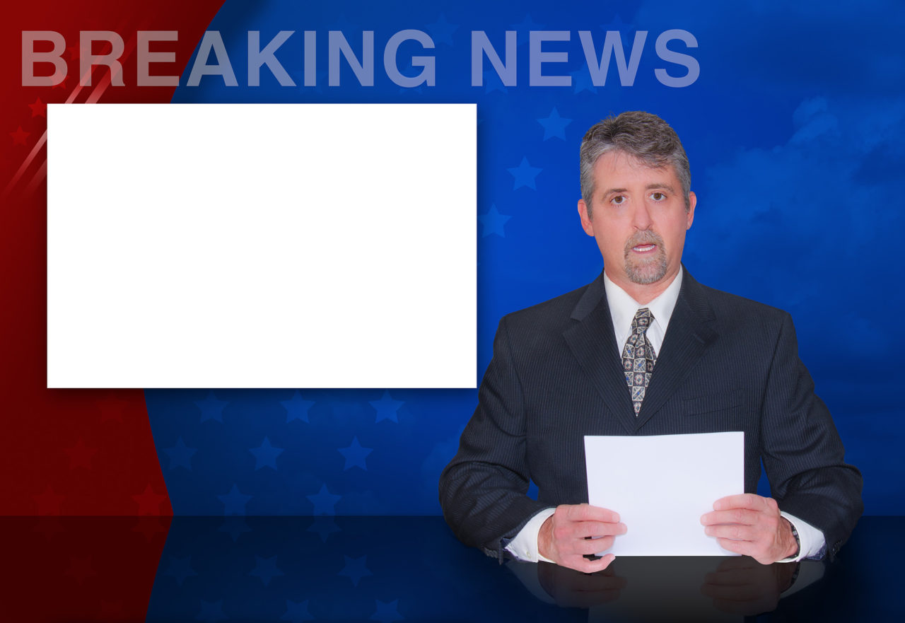 A news anchor man is reporting breaking news