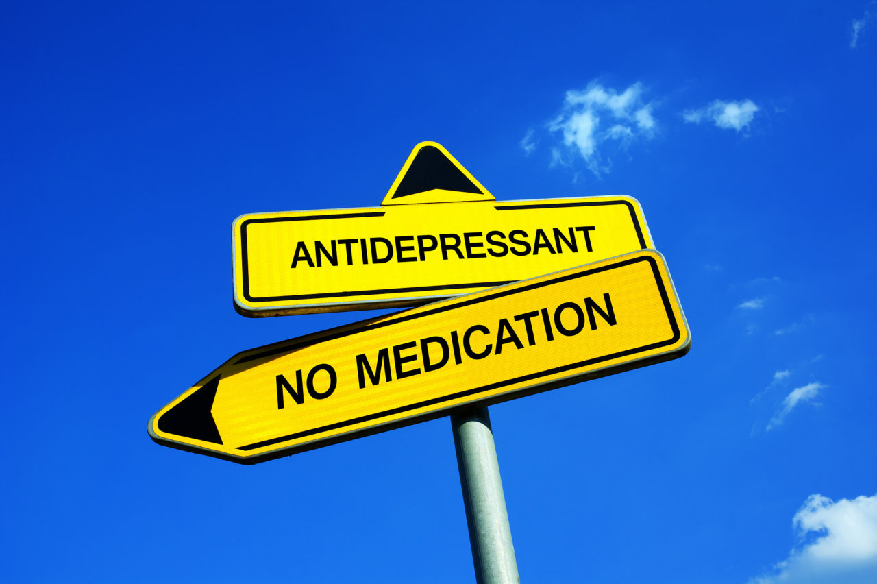 Antidepressant vs No Medication - Traffic sign with two options - appeal to avoid medicaments because of dangers ( side effects, addiction, numbness, apathy )