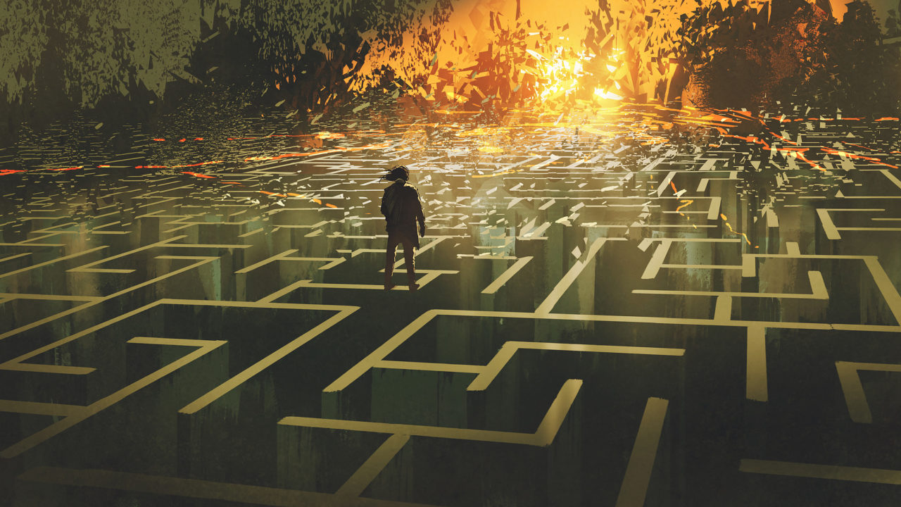 destroyed maze concept showing the man standing in a burnt labyrinth land