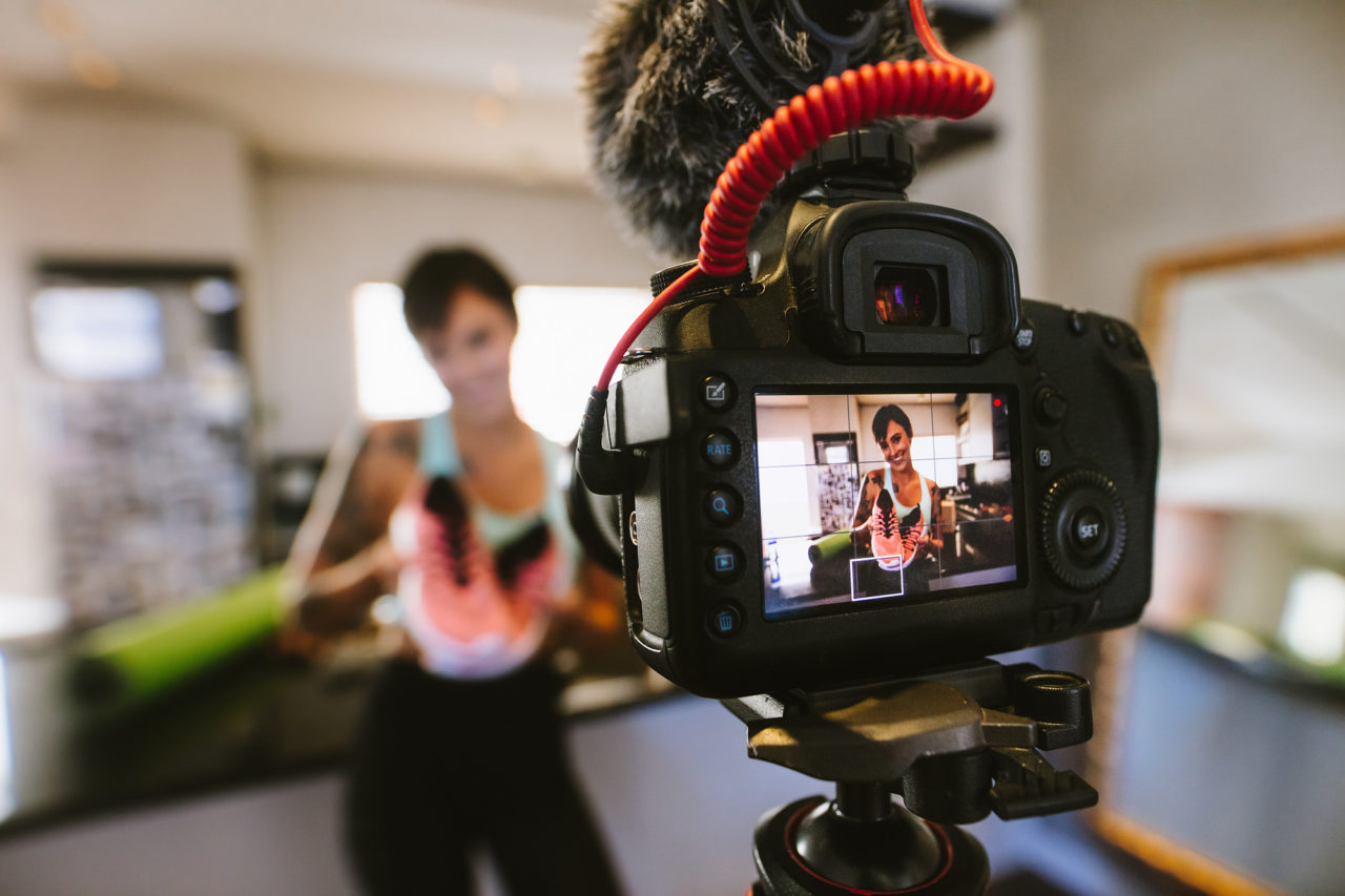 Social media influencer recording video for blog