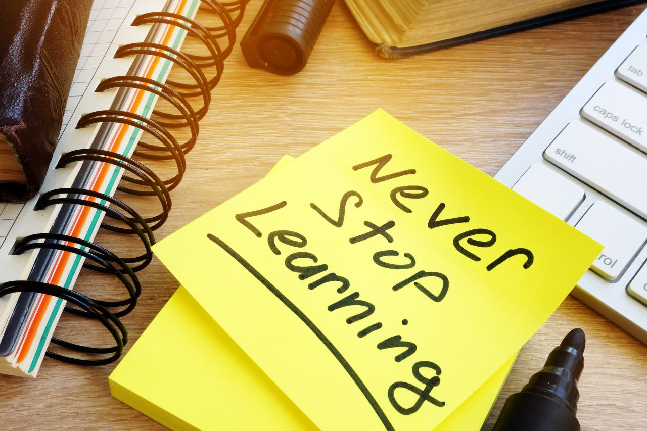 Never stop learning written on a memo stick.