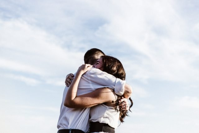 man and woman hugging each other photography photo