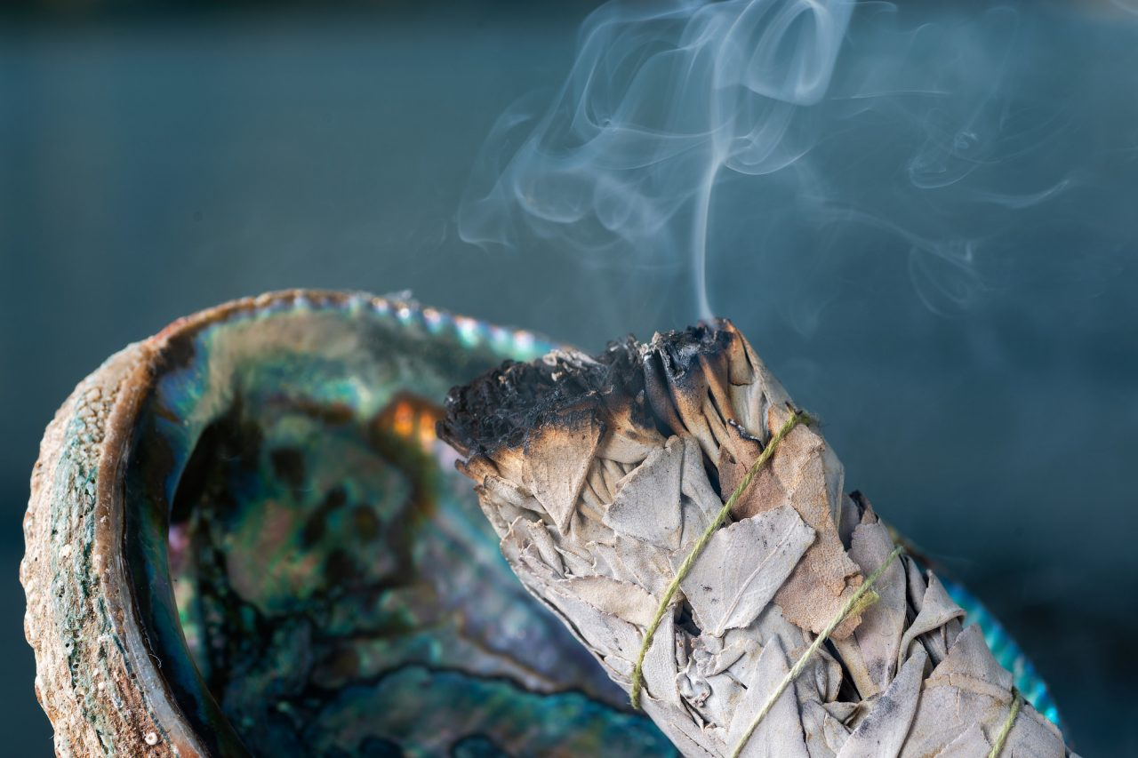 Smudging Ritual using burning thick leafy bundle of White Sage