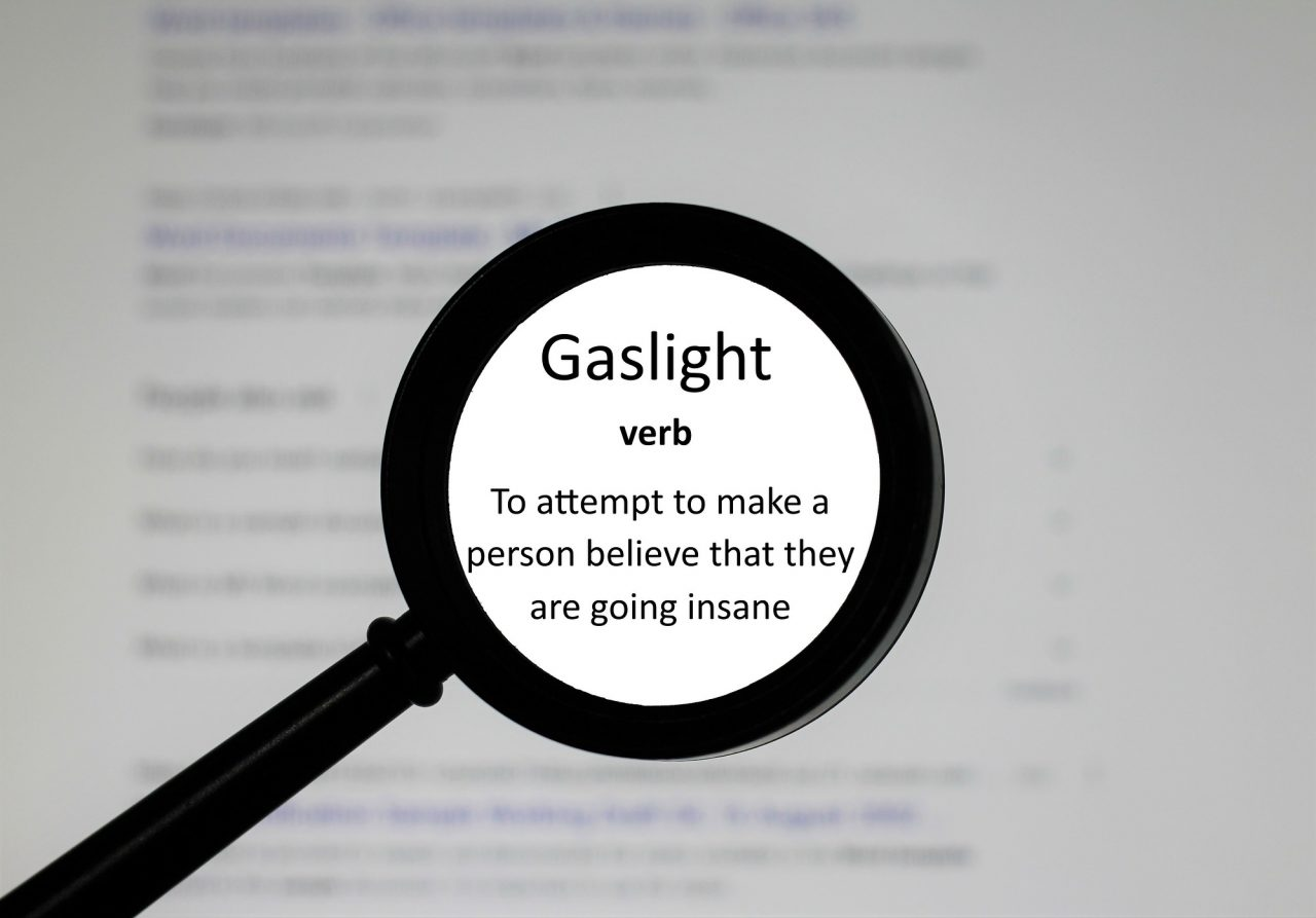 Selective focus on word Gaslight, word in a dictionary